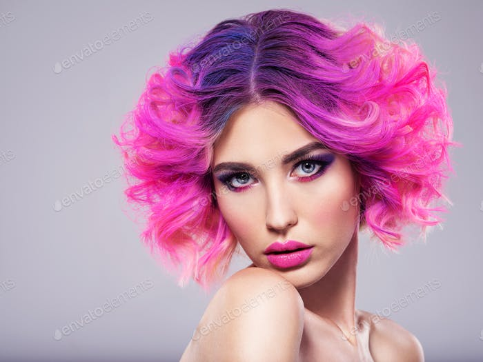 Portrait of beautiful young woman with bright pink makeup.