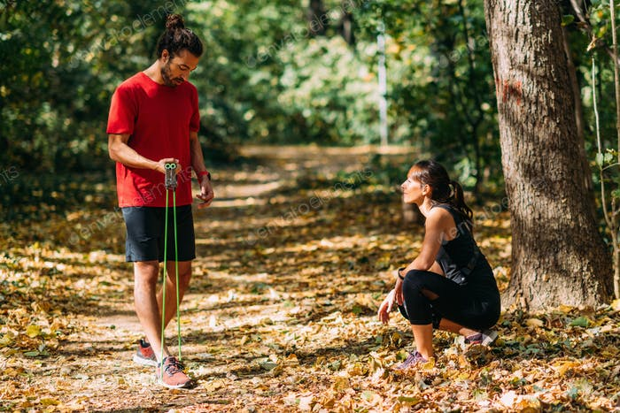 Young Couple Exercising with Elastic Resistance Bands