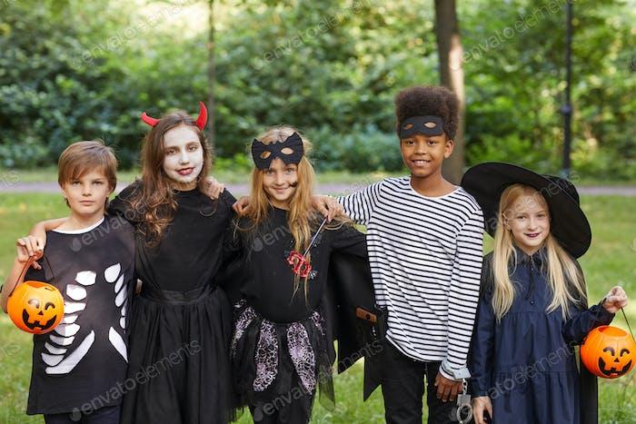 Children Wearing Halloween Costumes Outdoors