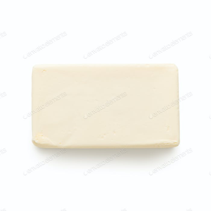 Block of butter on white