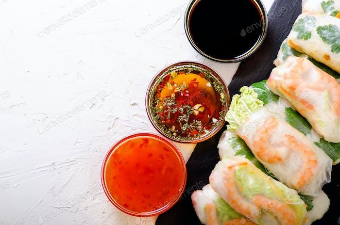 Vietnamese spring rolls - rice paper, lettuce, salad, vermicelli, noodles, shrimps, fish sauce