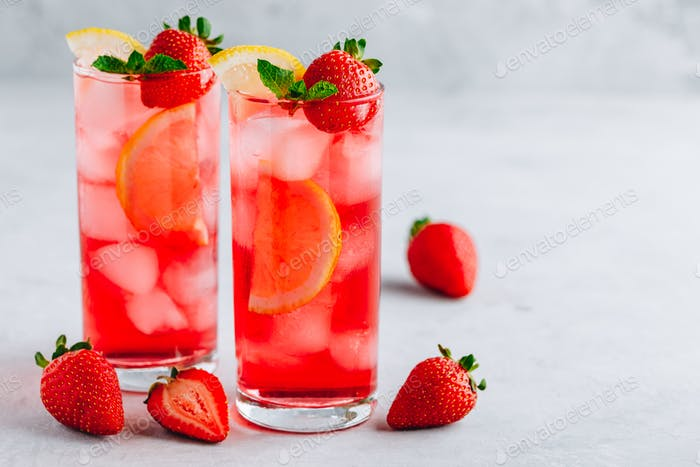 Refreshing Strawberry Mint and lemon Iced Tea or lemonade in glasses