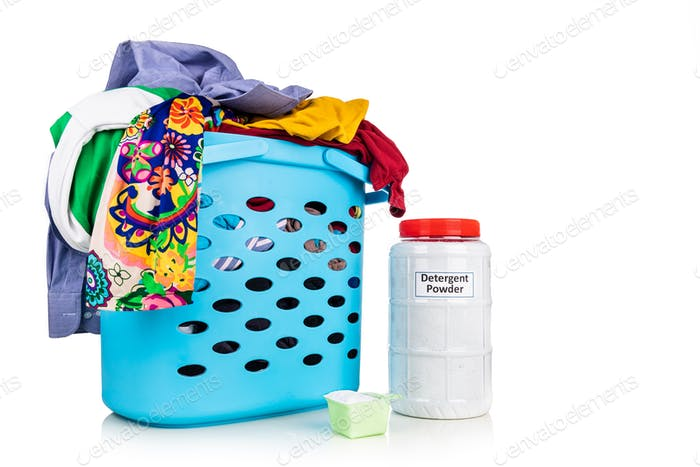 Fabric powder laundry detergent with scooper with basket full of apparels
