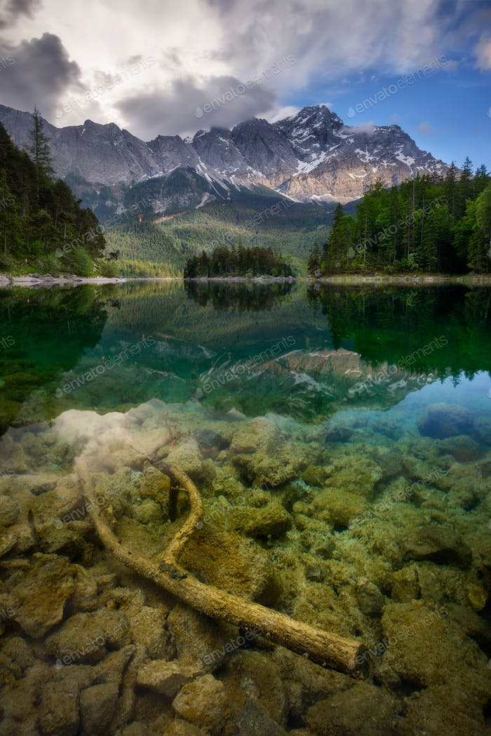 Beautiful reflection of highest mountain peak Zugspitze at Eibsee lake, Bavaria, Germany.