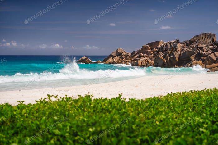 Ocean waves at Petite Anse, La Digue in Seychelles - Tropical and paradise beach. Luxury vacation