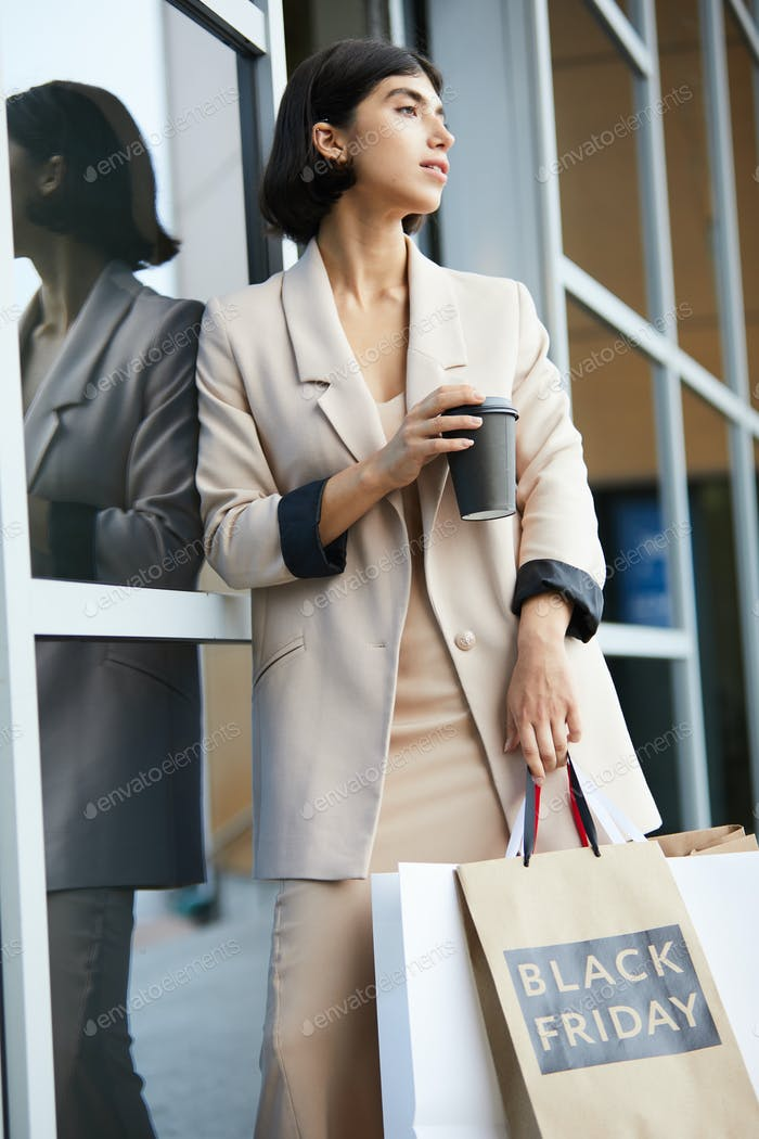 Beautiful Young Woman Leaving Boutique
