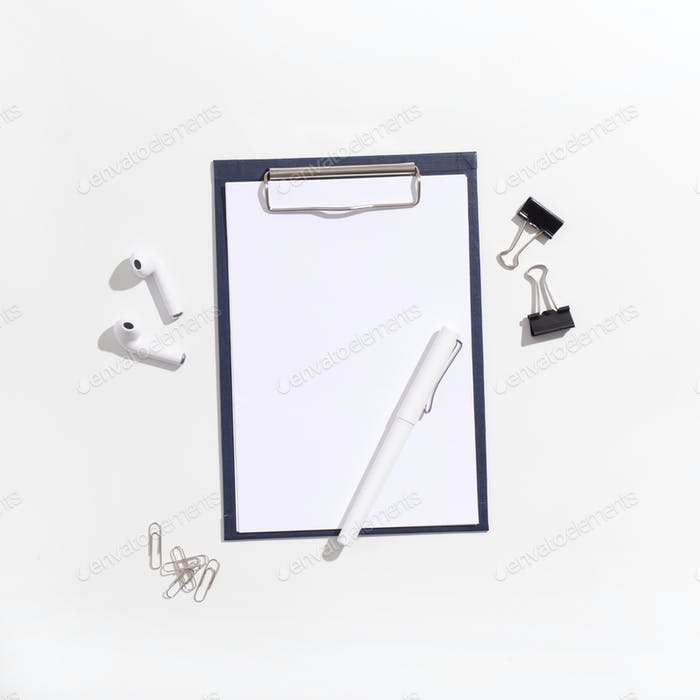 Clipboard with copy space for text and pen on white background