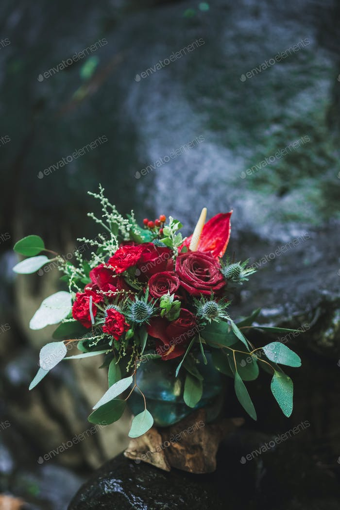 Wedding decorations with fresh red and vinous color flowers close up. Flowers arrangement on party
