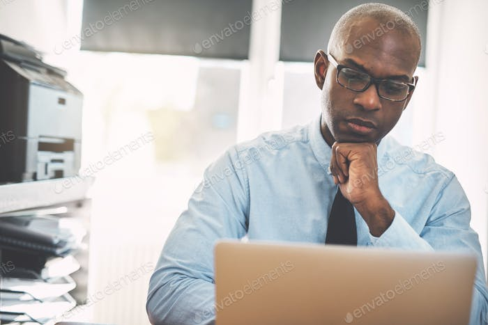 African businessman hard at work online in an office