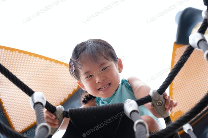Active little toddler girl on the playground