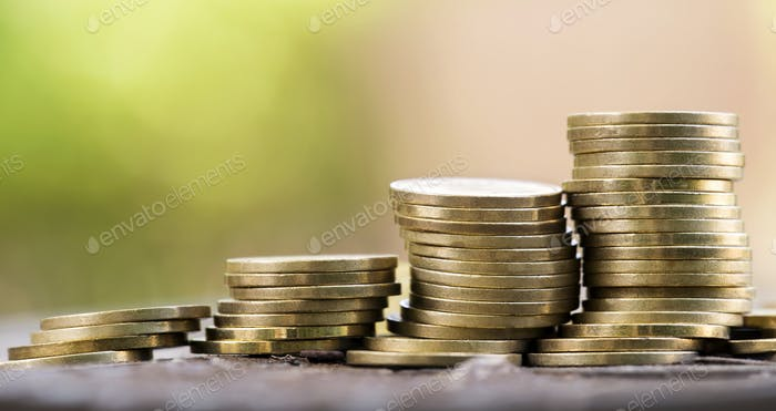 Money savings - gold coins stack
