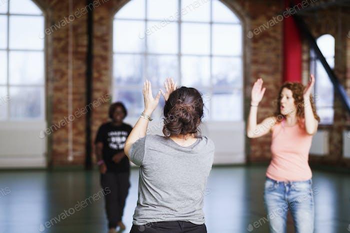 Women practicing during dance class