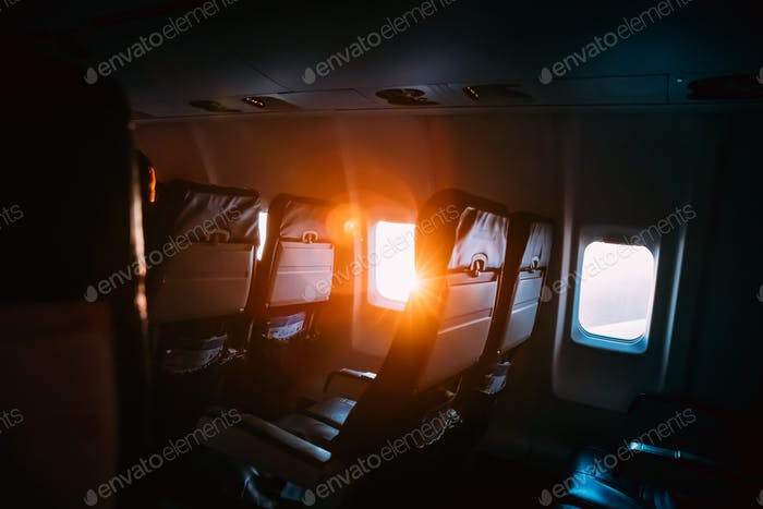 Sun Shining From Airplane Aircraft Plane Window In Cabin Cabin.