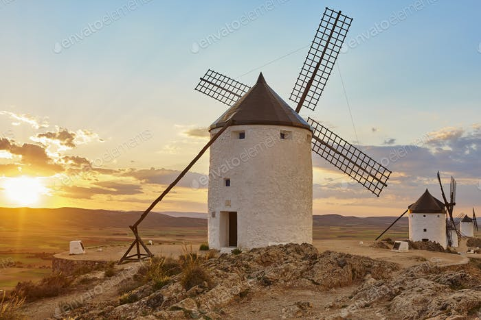 Traditional antique windmills at sunset in Spain. Consuegra, Toledo. Travel