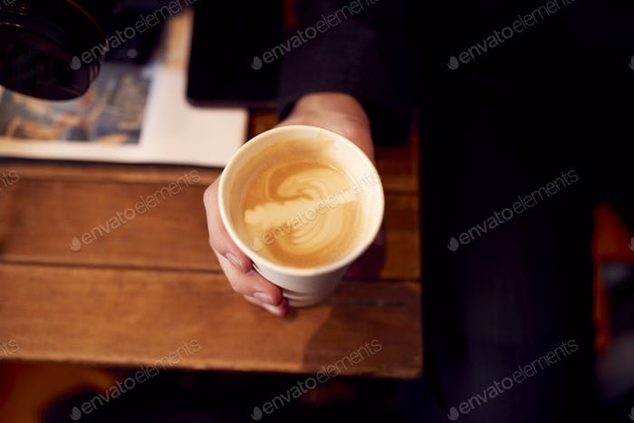 Close Up Of Hand Holding Takeaway Cup Of Coffee