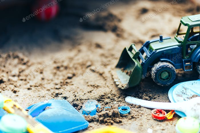 Summer Children's Toys on the sand, sand box, green tractor