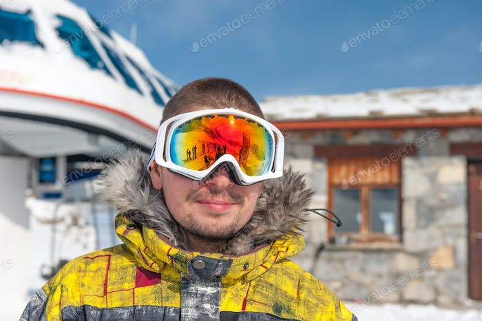 Young man in ski goggles outdoors