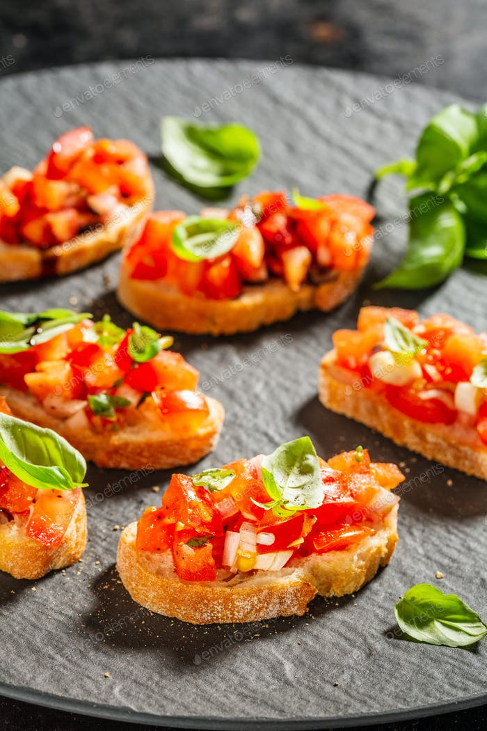 Classic italian bruschetta served on dark plate