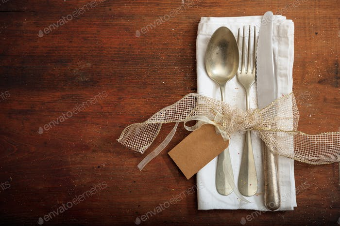 Table setting with tsg on wooden background