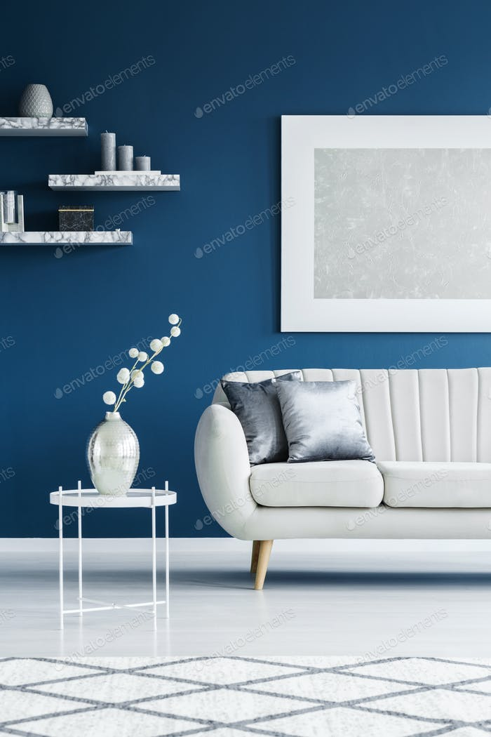 Couch on blue wall