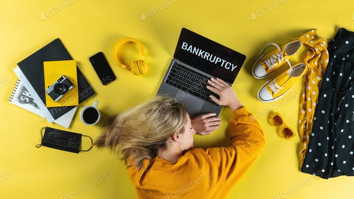 Top view of frustrated business woman at desk , coronavirus and bankruptcy desktop concept
