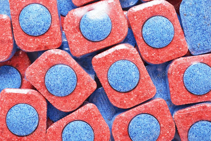 Heap of dishwasher detergent tablets background.