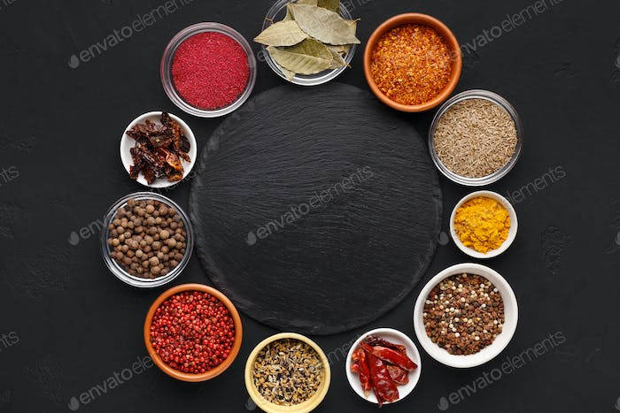 Assorted indian spices in circle with space for text