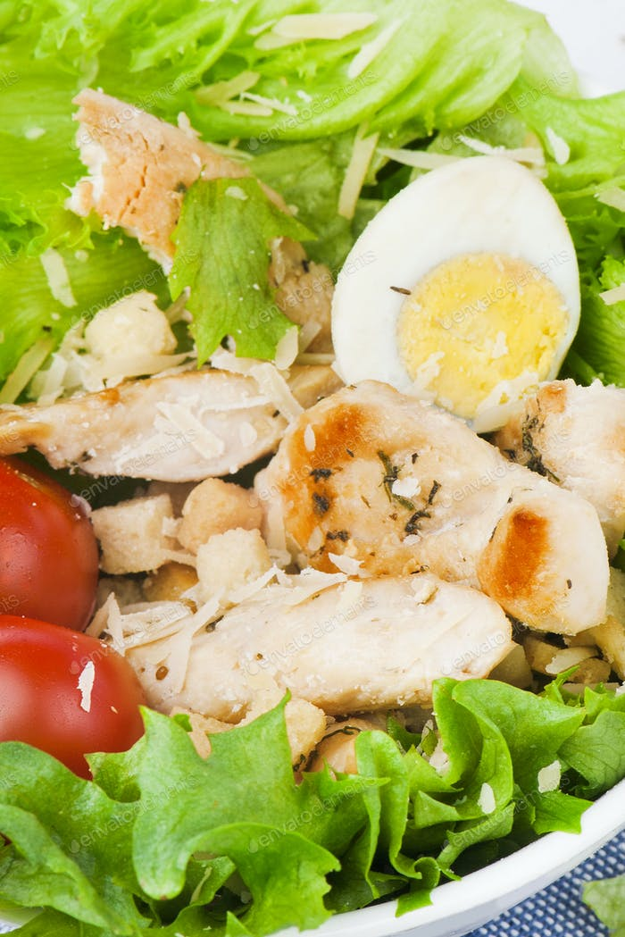 green salad with avocado rucola nuts and couscous vegetarian healthy food