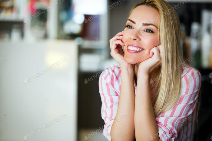 Portrait of beautiful young happy smiling woman with long hair