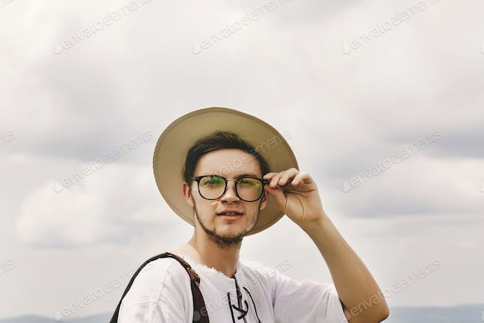 Stylish handsome hipster bearded man portrait with hat and glasses