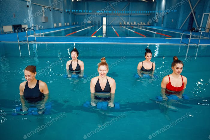 Female aqua aerobics, training with dumbbells