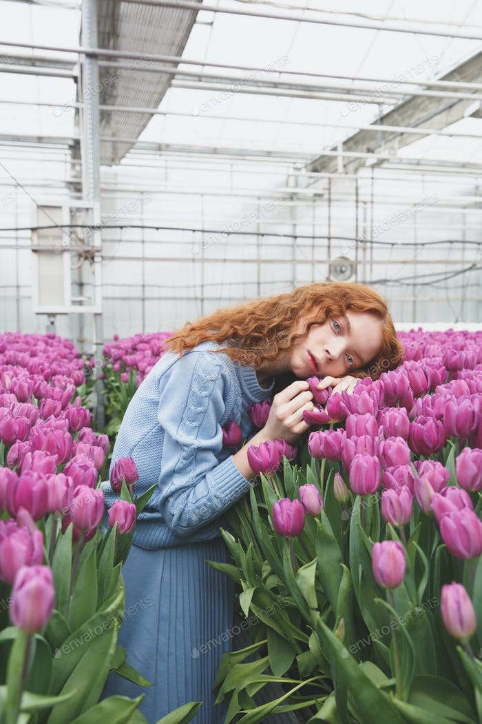 Girl lying on tulips
