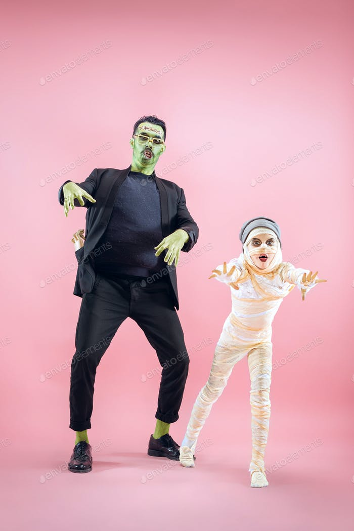 Halloween Family. Happy Father and Children Girl in Halloween Costume and Makeup