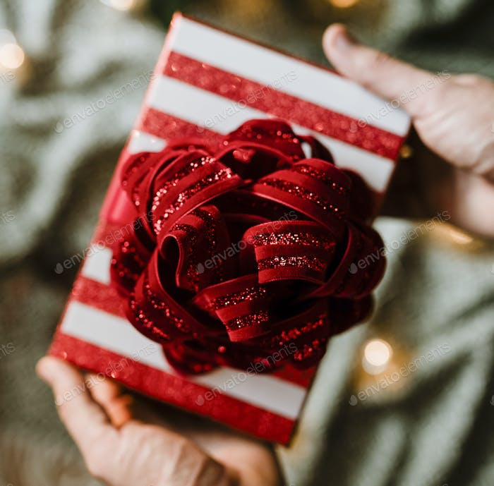 Gift with a red flower bow