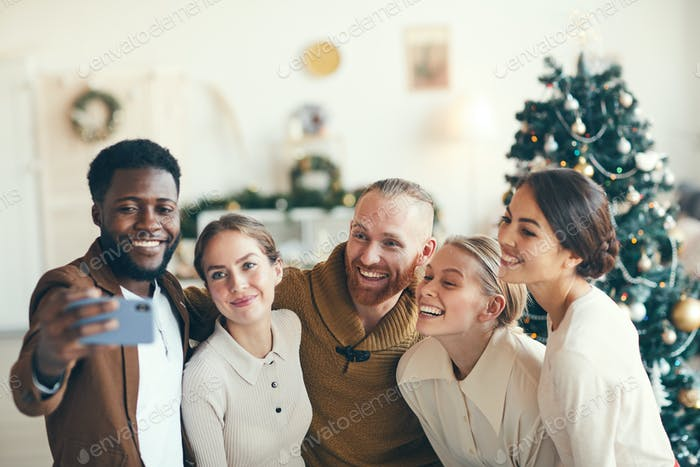 Friends Taking Selfie at Christmas Party