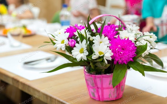 Fresh flower bouquet decorated with basket