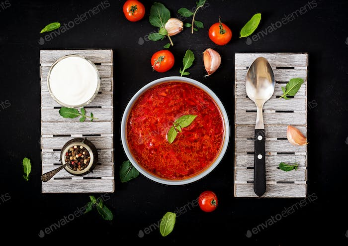 Traditional Ukrainian Russian vegetable borscht soup  on blue bowl. Flat lay. Top view