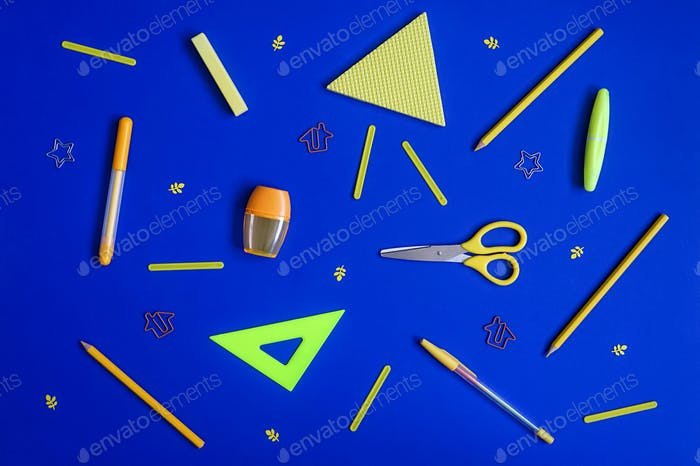 Stationery on blue. Bright flat lay.