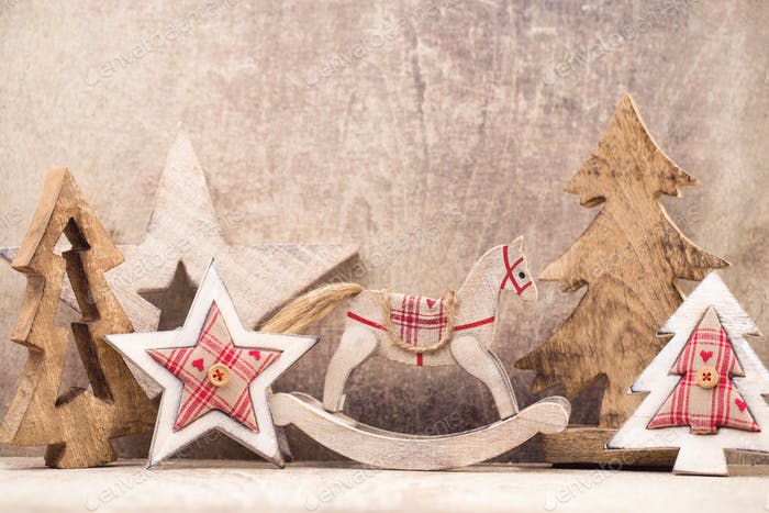 Christmas tree decorations on a wooden background. With bokeh ornaments.