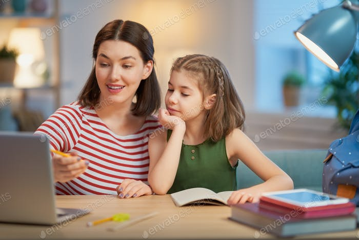 Girl doing homework with mother