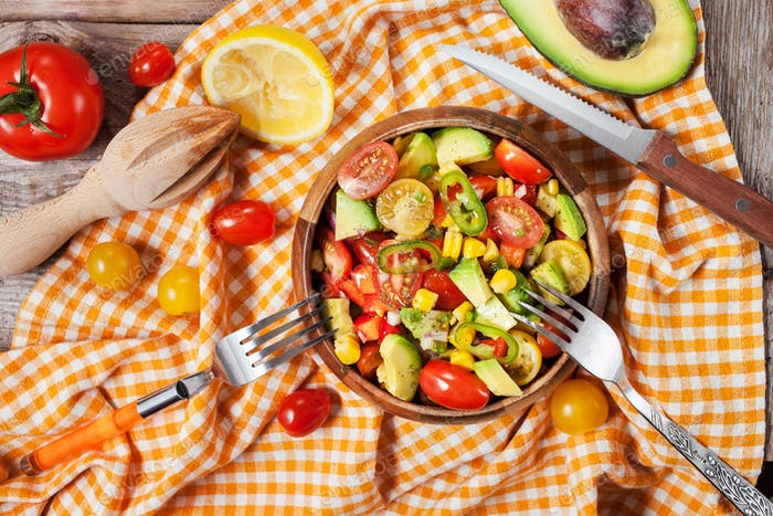 Salad with avocado, corn, tomatoes