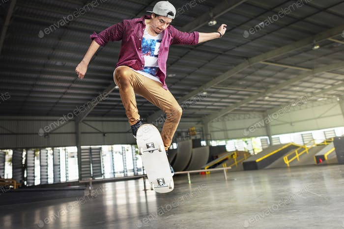 Boy Skateboarding Jump Lifestyle Hipster Concept