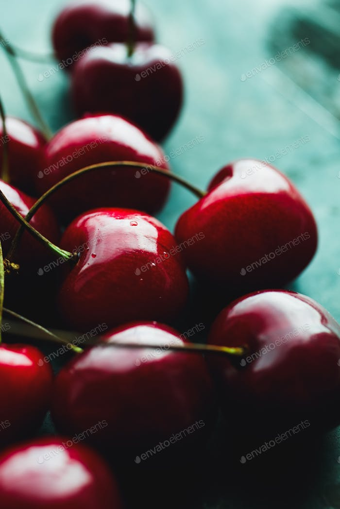 Ripe cherries on green
