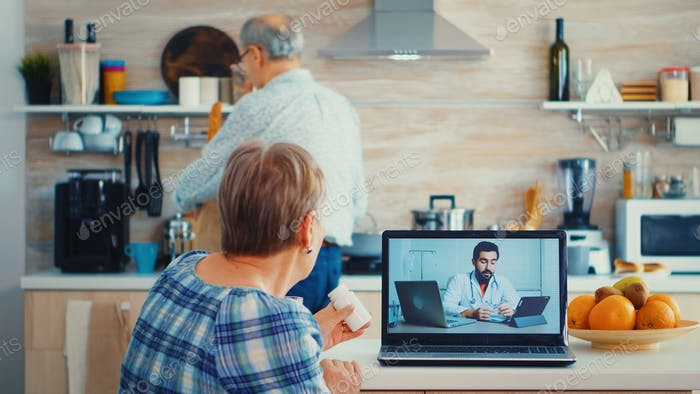 Elderly woman on telemedicine with doctor