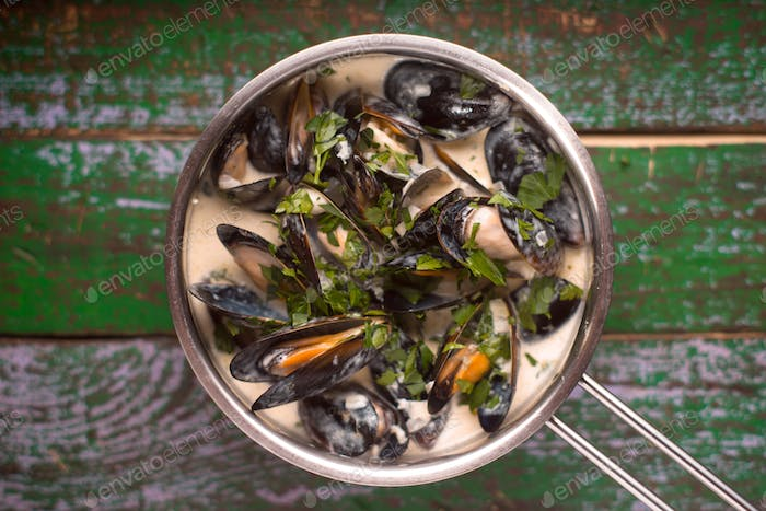 Mussels in Roquefort sauce on the old painted