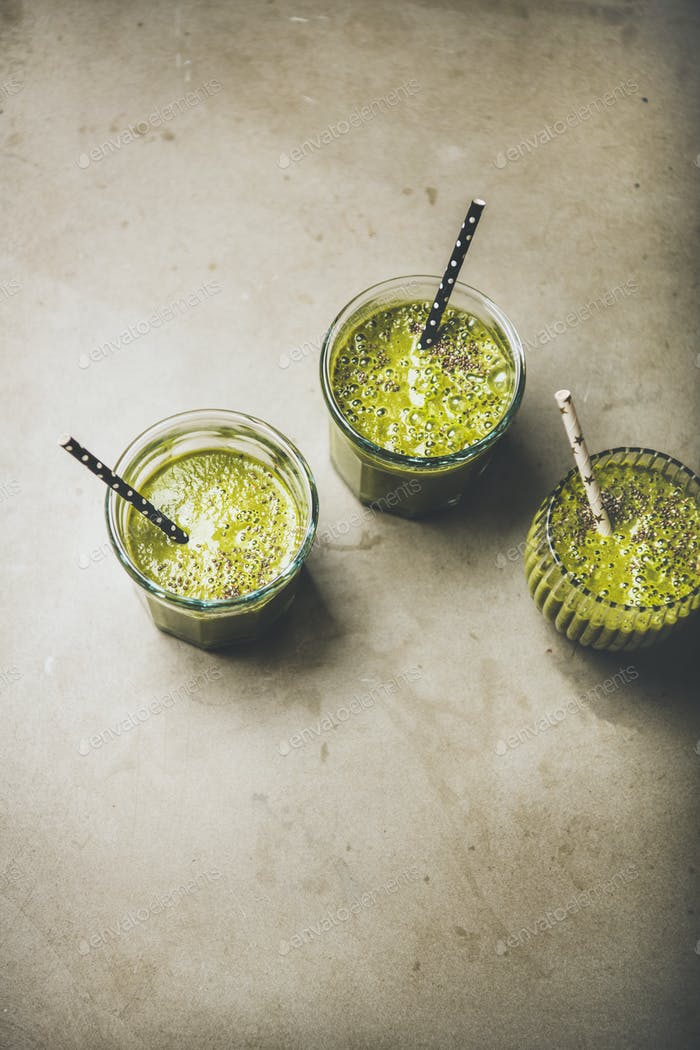 Vegan green smoothies in glasses with chia seeds, top view