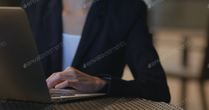 Businesswoman use of laptop computer at night