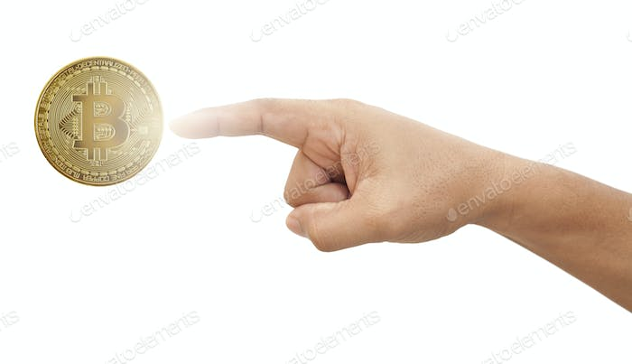 Hand touching bitcoin