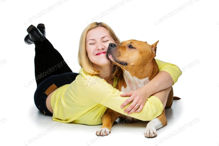 Girl with amstaff dog