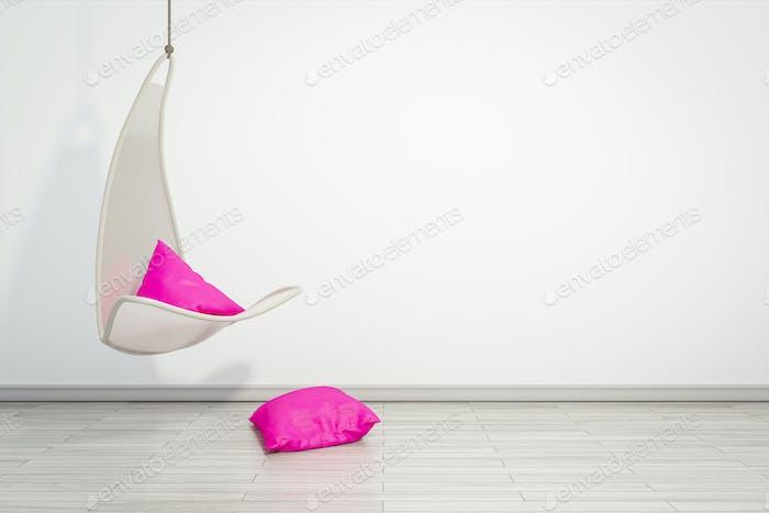 Hängesessel mit rosa Kissen